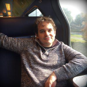Robin on Netherlands Train by Jennie Adams